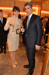 STEPHEN ALDEN CEO of the Maybourne Hotel Group and general manager for the Connaught Hotel NATHALIE SEILER-HAYEZ at the opening party for Moynat's new Maison de Vente in Mayfair at 112 Mount Street, London W1 on 12th March 2014.