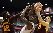 Zylan Chetham #14 of the San Diego State Aztecs battles for the ball against Mickey Mitchell #3 of the Arizona State Sun Devils at Viejas Arena on December 10, 2016 in San Diego, California.