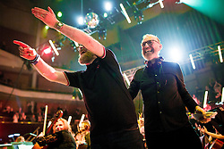 """© Licensed to London News Pictures . 05/02/2016 . Manchester , UK . DJs GRAEME PARK and MIKE PICKERING . """" Hacienda Classical """" debut at the Bridgewater Hall . The 70 piece Manchester Camerata and performers including New Order's Peter Hook , Shaun Ryder , Rowetta Idah , Bez and Hacienda DJs Graeme Park and Mike Pickering mixing live compositions . Photo credit : Joel Goodman/LNP"""