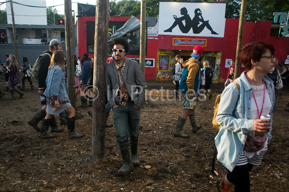 Dave Fuller from the performance group 15 secodns of fame in Shangri-la at the Glastonbury Festival 22th July 2016, Somerset, United Kingdom. Shangri-la is a venue at the festival with  art and politics mixed with tunes and all night club nights. Work getting the festival ready takes weeks and in the days up to the festival starts work is frantic.  The Glastonbury Festival runs over 3 days and has 3000 acts, including music, art and performance and approx. 150.000 attend the anual event.