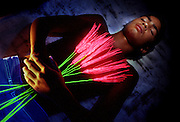 Young dead boy with glowing wheat.Black light