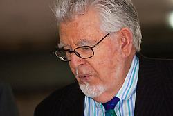 """London, May 19th 2014. Rolf Harris leaves Southwark Crown Court after another day of his trial on 12 counts of indecent assault,  where a witness alleged that when she was eleven Rolf Harris """"tongue kissed"""" her whilst she was staying at a friend's home when ill."""