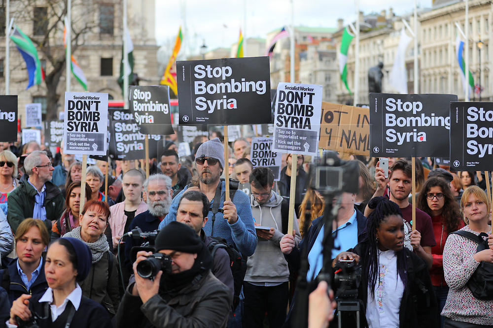 © Licensed to London News Pictures. 16/04/2018. London, UK. Demonstrators in Parliament Square protest against British airstrikes in Syria. RAF jets joined French and US forces in a 'precision strike' against Syrian military facilities in response to a chemical weapons attack in a Damascus suburb on Saturday 14 April 2018. Photo credit: Rob Pinney/LNP