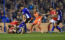 Sheffield Wednesday and Middlesbrough players scramble for the ball on the goal-line