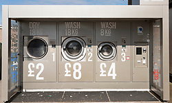 Outdoor laundromat for tourists on petrol station forecourt in Thurso on  the North Coast 500 scenic driving route in northern Scotland, UK