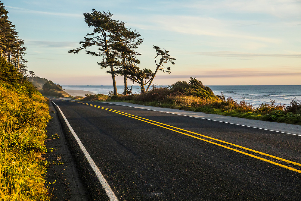 Highway 101 looking south along the Olympic Peninsula coast as the sun sets over the Pacific Ocean, Washington, USA.