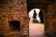A view through an old stone archway in Italy