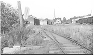 """View north (from RD143-003).  RGS freight house has been converted to Goose barn.<br /> RGS  Dolores, CO  Taken by Kelley, Frank O. - ? 8/27/1948<br /> In book """"Rio Grande Southern II, The: An Ultimate Pictorial Study"""" page 314<br /> Also in """"RGS Story Vol. VIII"""", p. 42 where it is dated 8/26/1948."""