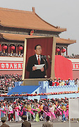 A float carrying a portrait of China's leader Jiang Zemin, is marched past Tiananmen Gate as China celebrates its 50th anniversary with a massive parade in Beijing October 1, 1999.