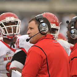 Oct 31, 2009; East Hartford, CT, USA; Rutgers head coach Greg Schiano checks the scoreboard during second half Big East NCAA football action in Rutgers' 28-24 victory over Connecticut at Rentschler Field.