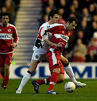 Photo: Jed Wee/Sportsbeat Images.<br /> Middlesbrough v Manchester United. The FA Cup. 10/03/2007.<br /> <br /> Middlesbrough's Mark Viduka (R) holds off the attentions of Manchester United's Michael Carrick.