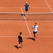 PARIS, FRANCE June 10. Desirae Krawczyk of the United States and Joe Salisbury of Great Britain (nearest camera) in action in the mixed doubles final against Elena Vesnina and Aslan Karatsev of Russia on Court Philippe-Chatrier during the 2021 French Open Tennis Tournament at Roland Garros on June 10th 2021 in Paris, France. (Photo by Tim Clayton/Corbis via Getty Images)