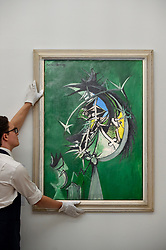 "© Licensed to London News Pictures. 17/07/2019. LONDON, UK. A technician presents ""Thorn Head"", 1947, by Graham Sutherland at the preview of ""Brave New Visions: The Émigrés who transformed the British Art World"", a new exhibition at Sotheby's gallery in New Bond Street which runs 17 July to 9 August 2019.  The show is also part of ""Insiders / Outsiders"", a nationwide, year long festival celebrating refugees from Nazi Europe and their contribution to British culture.  Photo credit: Stephen Chung/LNP"