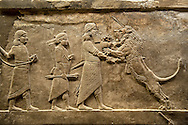 Assyrian relief sculpture panel of Ashurnasirpal lion hunting.  From Nineveh  North Palace, Iraq,  668-627 B.C.  British Museum Assyrian  Archaeological exhibit no  ME 124875. .<br /> <br /> If you prefer to buy from our ALAMY PHOTO LIBRARY  Collection visit : https://www.alamy.com/portfolio/paul-williams-funkystock/ancient-assyria-antiquities.html  Refine search by adding background colour, place, subject, museum etc into the LOWER SEARCH WITHIN GALLERY box to <br /> <br /> Visit our ANCIENT ASSYRIAN PHOTO COLLECTIONS for more photos to download or buy as wall art prints https://funkystock.photoshelter.com/gallery-collection/Ancient-Assyrian-Art-Artefacts-Antiquities-Historic-Sites-Pictures-Images-of/C0000cjRqQyJjLag