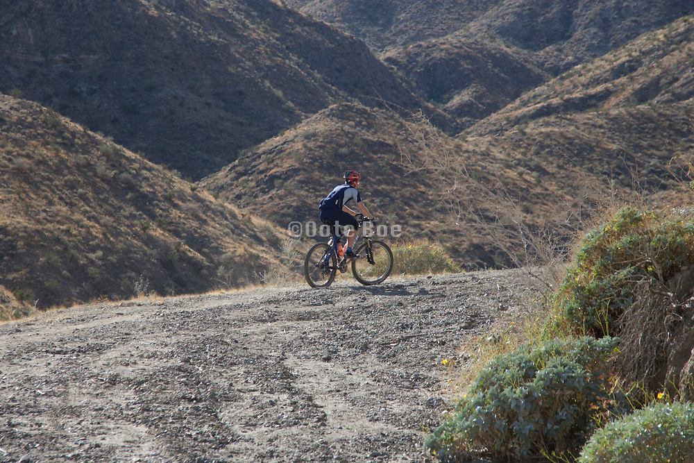 a mountain biker in the San Jacinto Mountain range near Palm springs USA