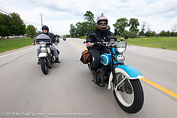 Jody Perewitz riding her 1936 Harley-Davidson with her riding partner Tom Banks just behind during the Cross Country Chase motorcycle endurance run from Sault Sainte Marie, MI to Key West, FL (for vintage bikes from 1930-1948). Stage 2 from Ludington, MI to Milwaukee, WI, USA. Saturday, September 7, 2019. Photography ©2019 Michael Lichter.