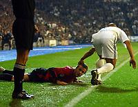 Photo. Javier Garcia<br />08/04/2003 Real Madrid v Man Utd, UEFA Champions League Quarter-Final first leg, Estadio Santiago Bernabeu<br />David Beckham looks to the linesman for help after a foul by Roberto Carlos