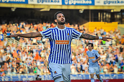 April 19, 2018 - San Sebastian, Spain - Willian Jose of Real Sociedad celebrates with teammates after scoring during the Spanish league football match between Real Sociedad and Atletico Madrid at the Anoeta Stadium on 19 April 2018 in San Sebastian, Spain  (Credit Image: © Jose Ignacio Unanue/NurPhoto via ZUMA Press)