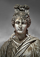 Roman statue of a woman. Marble. Perge. 2nd century AD. Inv no 2015/186. Antalya Archaeology Museum; Turkey. Against a grey background .<br /> <br /> If you prefer to buy from our ALAMY STOCK LIBRARY page at https://www.alamy.com/portfolio/paul-williams-funkystock/greco-roman-sculptures.html . Type -    Antalya     - into LOWER SEARCH WITHIN GALLERY box - Refine search by adding a subject, place, background colour, museum etc.<br /> <br /> Visit our ROMAN WORLD PHOTO COLLECTIONS for more photos to download or buy as wall art prints https://funkystock.photoshelter.com/gallery-collection/The-Romans-Art-Artefacts-Antiquities-Historic-Sites-Pictures-Images/C0000r2uLJJo9_s0