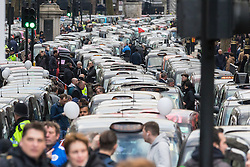 Whitehall, London, February 10th 2016. A river of taxis on Whitehall as an estimated 8,000 cabbies hold a go-slow in protest against what they say is unfair competition from minicab and Uber drivers who do not have to undergo the rigorous training and checks required for the licenced taxi trade. ///FOR LICENCING CONTACT: paul@pauldaveycreative.co.uk TEL:+44 (0) 7966 016 296 or +44 (0) 20 8969 6875. ©2015 Paul R Davey. All rights reserved.