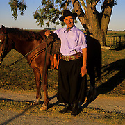 South America, Uruguay, Florida, An authentic gaucho and his horse on a working ranch.