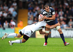 Bristol's Redford Pennycook is tackled by Newcastle's Tane Tuipuloto - Photo mandatory by-line: Josephmeredith.com  - Tel: Mobile:07966 386802 02/09/2012 - SPORT - RUGBY - Memorial Stadium - Bristol. Bristol Rugby v Newcastle Falcons