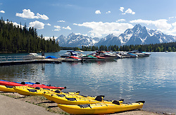 Teton National Park, WY:  Colter Bay and Marina, backdropped by Mt. Moran and glaciers. Boating and kayaking, as well as lake tours, are popular.
