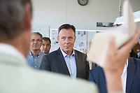 26 AUG 2015, ALFELD/GERMANY:<br /> Thomas Oppermann, SPD Fraktionsvorsitzender, waehrend dem Besuch des Fagus-Werkes im Rahmen von Oppermanns Sommerreise<br /> IMAGE: 20150826-01-040