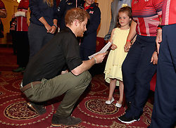 Prince Harry meets six year-old Maya Turner during the launch of the UK's Invictus Games team at Plaisterers Hall.