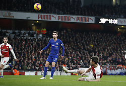BRITAIN-LONDON-FOOTBALL-PREMIER LEAGUE-ARSENAL VS CHELSEA.(190120) -- LONDON, Jan. 20, 2019  Arsenal's Laurent Koscielny (on ground) heads the 2nd goal during the English Premier League match between Arsenal and Chelsea at the Emirates Stadium in London, Britain on Jan. 19, 2019. Arsenal won 2-0.  FOR EDITORIAL USE ONLY. NOT FOR SALE FOR MARKETING OR ADVERTISING CAMPAIGNS. NO USE WITH UNAUTHORIZED AUDIO, VIDEO, DATA, FIXTURE LISTS, CLUB/LEAGUE LOGOS OR ''LIVE'' SERVICES. ONLINE IN-MATCH USE LIMITED TO 45 IMAGES, NO VIDEO EMULATION. NO USE IN BETTING, GAMES OR SINGLE CLUB/LEAGUE/PLAYER PUBLICATIONS. (Credit Image: © Matthew Impey/Xinhua via ZUMA Wire)