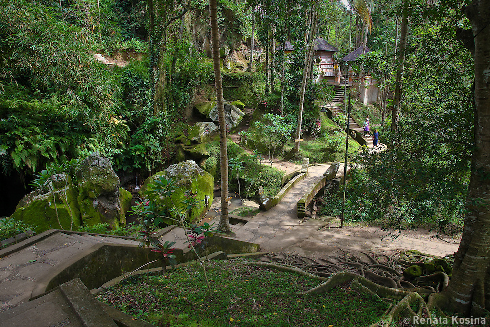 A walk through Goa Gajah temple garden reveals a labyrinth of winding paths through rocky cliffs, lush tropical vegetation and temples.