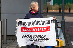 London, UK. 4 September, 2019. An anti-nuclear activist holds a banner during protests outside ExCel London on the third day of a week-long carnival of resistance against DSEI, the world's largest arms fair. The third day's protests were organised by the Campaign for Nuclear Disarmament (CND) and Trident Ploughshares.