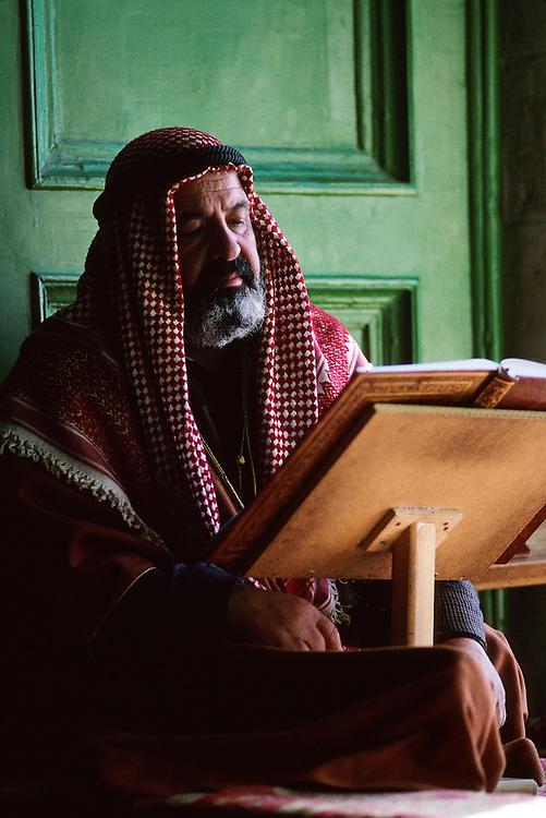 A man reading the Koran.