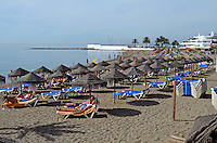 Beach, playa, shore, shoreline, recliners, daytime, sun loungers, sunbathing, sunbathers, Marbella, Spain, leisure, holidays, vacations, 201310152873<br /> <br /> Copyright Image from Victor Patterson, 54 Dorchester Park, Belfast, UK, BT9 6RJ<br /> <br /> Tel: +44 28 9066 1296<br /> Mob: +44 7802 353836<br /> Voicemail +44 20 8816 7153<br /> Skype: victorpattersonbelfast<br /> Email: victor@victorpatterson.com<br /> Email: victorpatterson@me.com (back-up)<br /> <br /> IMPORTANT: If you wish to use this image or any other of my images please go to www.victorpatterson.com and click on the Terms & Conditions. Then contact me by email or phone with the reference number(s) of the image(s) concerned.