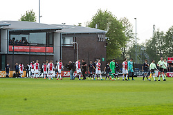 the teams of Jong Ajax and MVV Maastricht enter the pitch during the Jupiler League match between Ajax U23 and MVV Maastricht at De Toekomst on April 28, 2018 in Amsterdam, The Netherlands