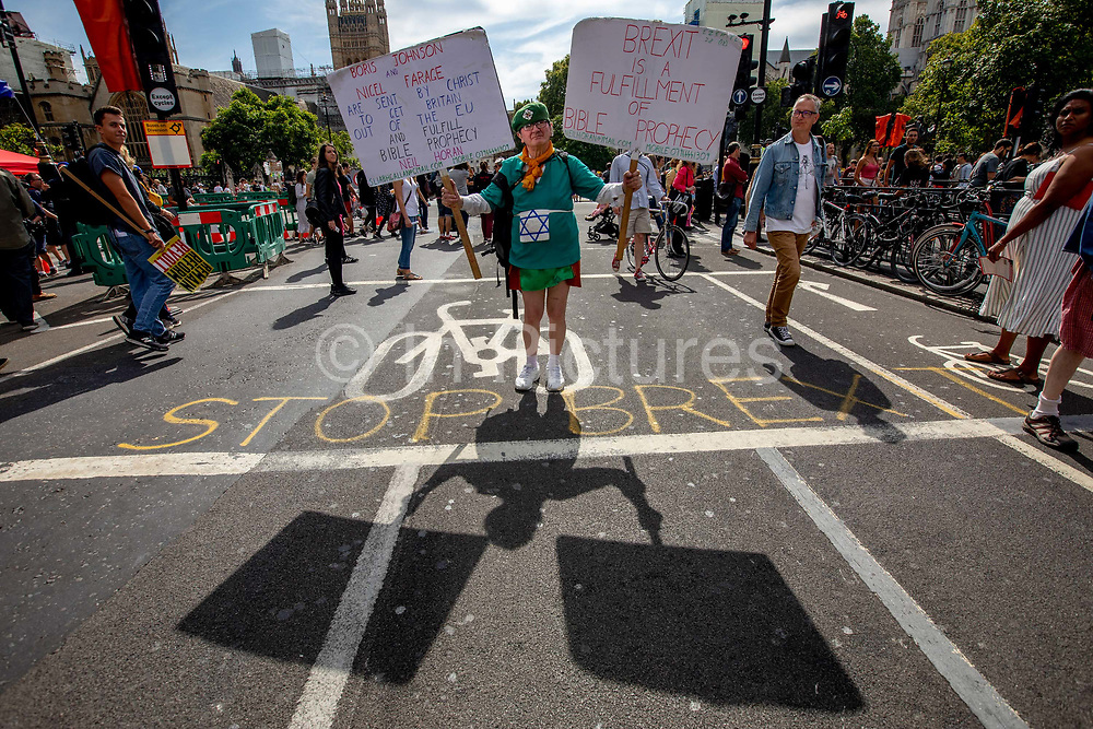 A brexiter in Irish fancy dress during the  the Stop The Coup protest against the proroguing of Parliament on 31st August 2019 in London in the United Kingdom. Left-wing group Momentum and the Peoples Assembly coordinated a series of Stop The Coup protests across the UK today, aimed at Boris Johnson and the UK government proroguing Parliament.