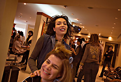Samer Breitaa jokes with customers while doing hair at a salon, Beirut, Lebanon, March 20, 2006. Breitaa, who is half-Christian, half-Muslim, has had extensive plastic surgery done to achieve his unique look. The Lebanese continue to recreate their identity after years of war.