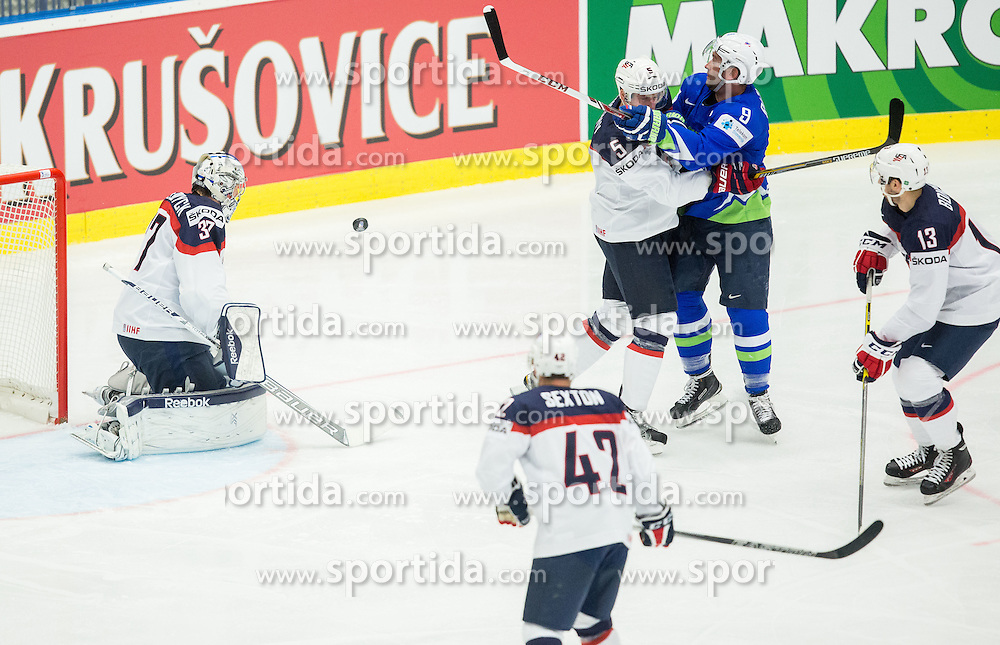Tomaz Razingar of Slovenia vs Connor Murphy of USA and Connor Hellebuyck of USA during Ice Hockey match between Slovenia and USA at Day 10 in Group B of 2015 IIHF World Championship, on May 10, 2015 in CEZ Arena, Ostrava, Czech Republic. Photo by Vid Ponikvar / Sportida