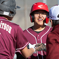 Tohatchi Cougars junior Cowin Long (22) is greeted by teammate Woodrow Long (5) and coach Ray Fransisco after scoring a run against the Navajo Pine Warriors at Ford Canyon Park in Gallup Friday.