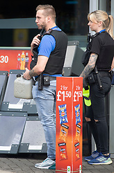 © Licensed to London News Pictures 28/09/2021.<br /> Mottingham, UK, Two police officers walk onto the forecourt with a jerry can with the hope of getting fuel but then promptly decided against the idea after watching the pandemonium. A tanker has just delivered fuel to Mottingham BP station in South East London. Within minutes of the tanker arriving motorists started to queue blocking roads. BP has started to ration petrol and diesel due to a shortage of truckers. Photo credit:Grant Falvey/LNP