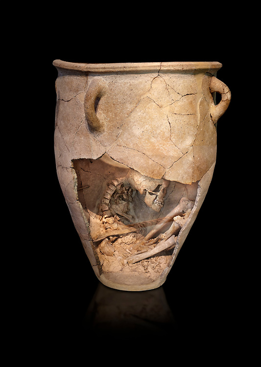 The Minoan clay burial pithos with skeleton in foetal,  Neopalatial period 1700-1450 BC; Heraklion Archaeological  Museum, black background<br /> <br /> The body was placed in a foetal postion to aid insertion into the wide mouthed pithos .<br /> <br /> If you prefer to buy from our ALAMY PHOTO LIBRARY  Collection visit : https://www.alamy.com/portfolio/paul-williams-funkystock/minoan-art-artefacts.html . Type -   Heraklion   - into the LOWER SEARCH WITHIN GALLERY box. Refine search by adding background colour, place, museum etc<br /> <br /> Visit our MINOAN ART PHOTO COLLECTIONS for more photos to download  as wall art prints https://funkystock.photoshelter.com/gallery-collection/Ancient-Minoans-Art-Artefacts-Antiquities-Historic-Places-Pictures-Images-of/C0000ricT2SU_M9w