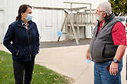 "14 OCTOBER 2020 - KNOXVILLE, IOWA: THERESA GREENFIELD, the Democratic candidate for US Senator from Iowa, (left) talks to MAX SMITH at Smith Fertilizer and Grain. Greenfield toured Smith Fertilizer and Grain in Knoxville and talked to owner Max Smith about her ""Fair Shot for Our Farmers"" plan to improve Iowa's farm economy. Greenfield is in a tight race with incumbent Republican Senator Joni Ernst.        PHOTO BY JACK KURTZ"