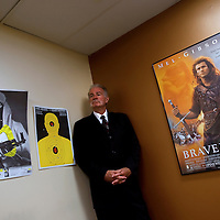 GAINESVILLE, FL -- August 18, 2010 -- Pastor Terry Jones poses for a portrait in his office under bullet-ridden targets and a Braveheart poster at the Dove World Outreach Center in Gainesville, Fla., on Wednesday, August 18, 2010.  The church is planning on burning multiple copies of the Koran on the anniversary of the September 11th terrorist attacks.  (Chip Litherland for The New York Times)