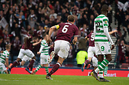 Hearts Captain Christophe Berra heads off to celebrate  his side taking the lead during the William Hill Scottish Cup Final match between Heart of Midlothian and Celtic at Hampden Park, Glasgow, United Kingdom on 25 May 2019.