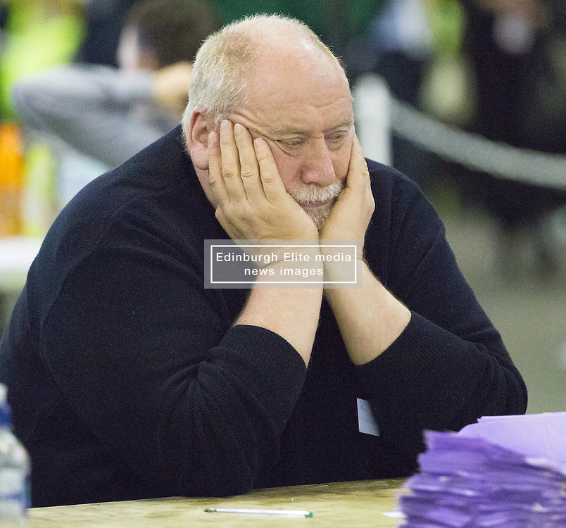 Scottish Parliament Election 2016 Royal Highland Centre Ingliston Edinburgh 05 May 2016; an exhausted counter shuts his eyes for a rest during the Scottish Parliament Election 2016, Royal Highland Centre, Ingliston Edinburgh.<br /> <br /> (c) Chris McCluskie | Edinburgh Elite media