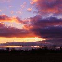 """""""The Heavens Opened""""<br /> <br /> Beautiful clouds move swiftly across the sky in this lovely rural Michigan, winter sunset!!<br /> <br /> Sunset Images by Rachel Cohen"""