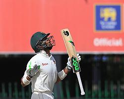 July 16, 2017 - Colombo, Sri Lanka - Zimbabwe's Sikandar Raza looks up to the sky and reacts after scoring fifty runs during the third day's play of the only test cricket match between Sri Lanka and Zimbabwe in Colombo, Sri Lanka, Sunday, July 16, 2017. (Credit Image: © Tharaka Basnayaka/NurPhoto via ZUMA Press)