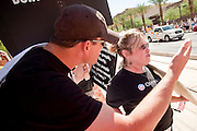 17 AUGUST 2009 -- PHOENIX, AZ: Geoff Turley (CQ) from Mesa, and Lisbeth Applefield, (CQ) from Scottsdale, discuss the merits of the Obama healthcare reform proposals. Turley, a strict constitutionalist, is opposed to government supported healthcare on constitutional grounds. Applefield supports healthcare reform. About 5,000 people were expected to demonstrate in favor of President Obama's health care proposals. Nearly 1,500 showed up to demonstrate against the President. PHOTO BY JACK KURTZ