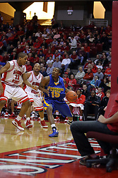 06 December 2008: Kellen Thornton works to block a baseline being exploited by Brandon Shingles during a game where the  Illinois State University Redbirds extended their record to 9-0 with a 76-70 win over the Eagles of Morehead State on Doug Collins Court inside Redbird Arena on the campus of Illinois State University in Normal Illinois