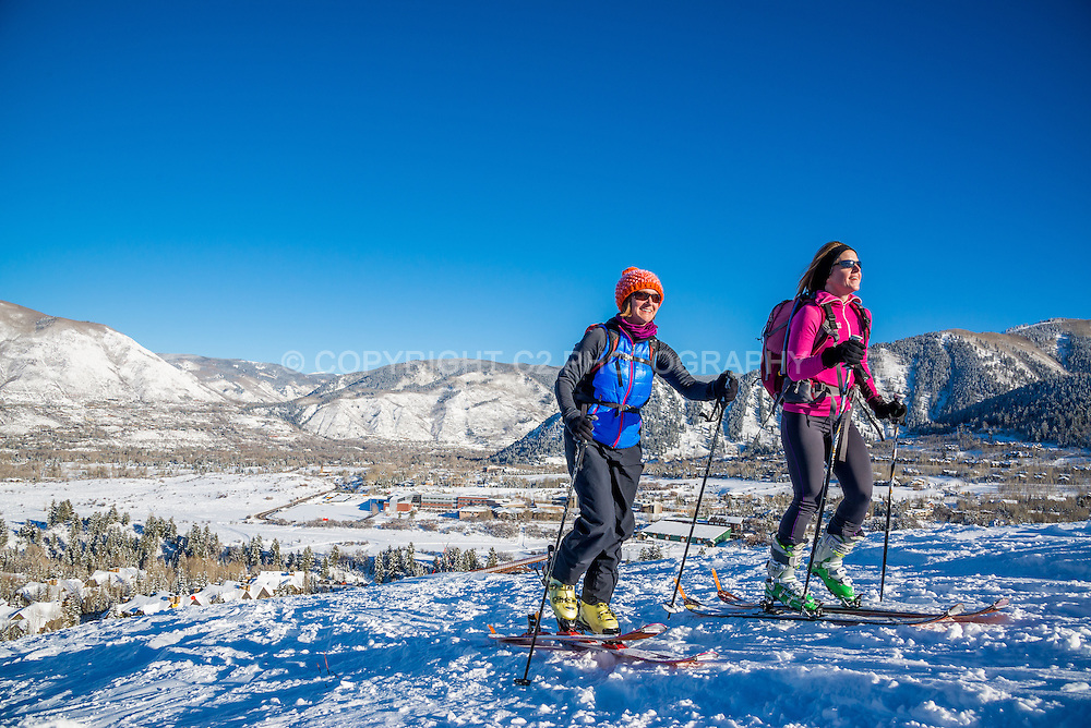 Skiers skin up Tiehack on Buttermilk Mountain in Aspen, Colorado.